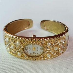Bejeweled hinged band bracelet wristwatch